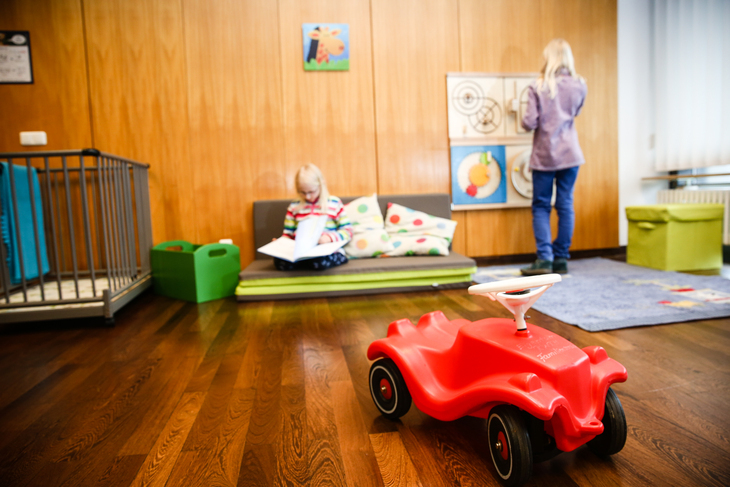 Child plays in a room