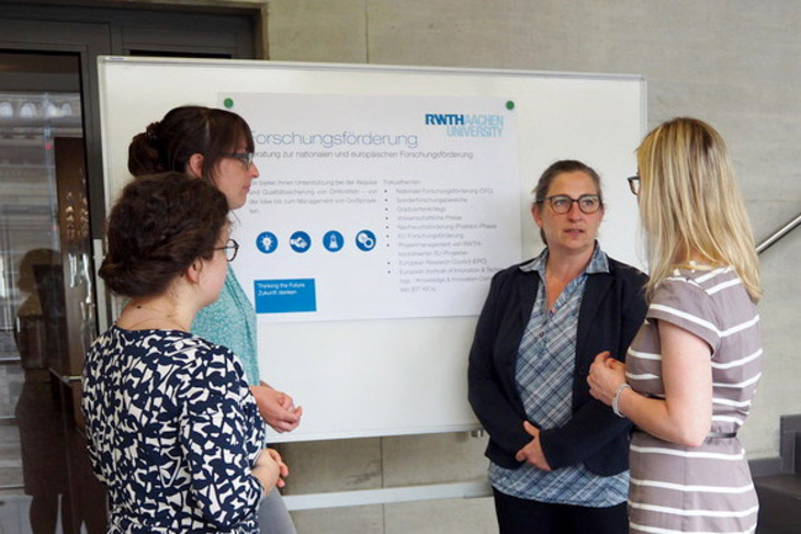 Four women in front of a flip chart